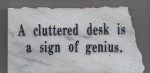 cluttered desk sign