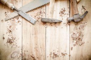 """Carpenter Tools,hammer,nails,shavings, And Chisel On Wooden"" Image courtesy of bugtiger at FreeDigitalPhotos.net"